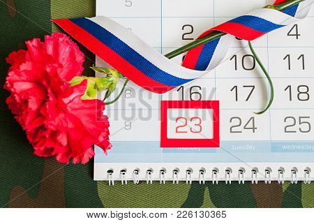 23 February, Defender Of The Fatherland Day, Festive Card. Red Carnation, Russian Flag And Calendar