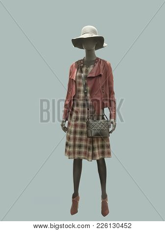 Full-length Female Mannequin Dressed In Fashionable Clothes. No Brand Names Or Copyright Objects.
