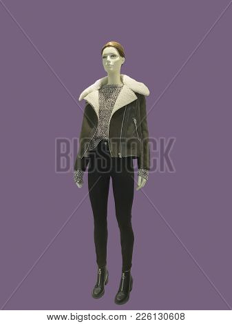 Full-length Female Mannequin Dressed In Warm Brown Jacket, Isolated. No Brand Names Or Copyright Obj