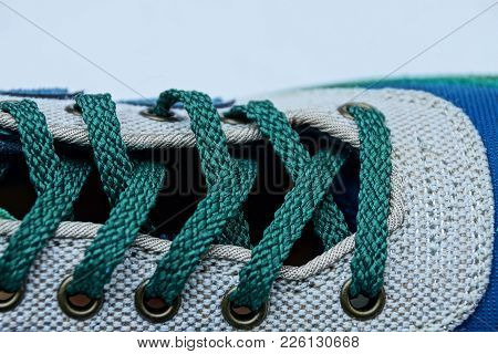 Green Shoelaces On A Colored Leather Boot