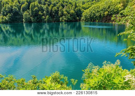 Plitvice Lakes National Park, Croatia, Europe. Natural Park With Waterfalls And Turquoise Water. Une