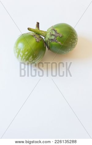 Crossed Stems Of Thai Eggplants Solanum Melongena Food Ingredients, Isolated On White, Copy Space Be