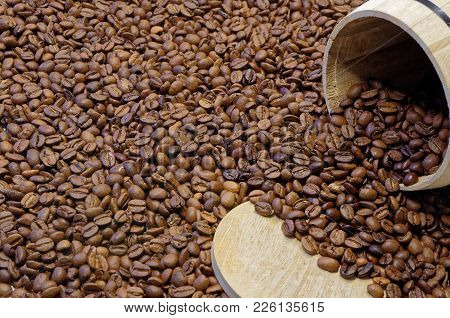 Roasted Coffee Beans And A Wooden Tin