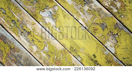 Abandoned Place Decoration. Dry Yellow Paint On The Wooden Surface. Peeling. Cracked Texture. Scratc