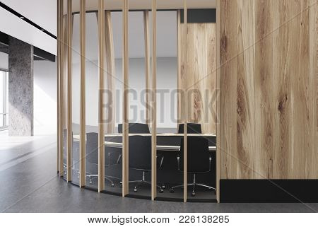 Round Wooden Conference Room Interior With Wooden Walls, A Round Table With Black Chairs Near It And