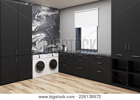Black Marble Washroom Corner With Black Marble Walls, Two Washing Machines, And Black Closets And Co