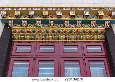 Coorg, India - October 29, 2013: Colorfully Decorated Beam Above Window  At Padmasambhava Vihara At