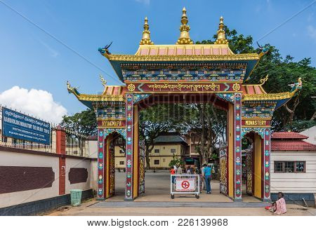 Coorg, India - October 29, 2013: Main Entrance To Namdroling Buddhist Monastery. With People Enterin