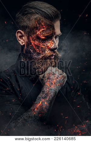 Creepy Demonic Male In A Fire Sparks And Smoke.