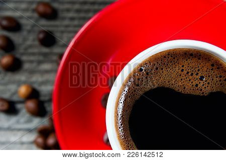 Top View A Red Mug Of Dark Coffee Closeup