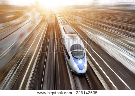 High-speed Passenger Train Travels At High Speed. Top View With Motion Effect, Greased Background