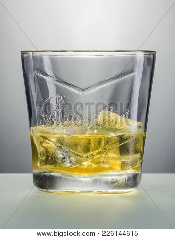 Kwidzyn, Poland - December 10, 2017: Glass Of Ballantines Whisky On Ice. Ballantines Is Blended Scot