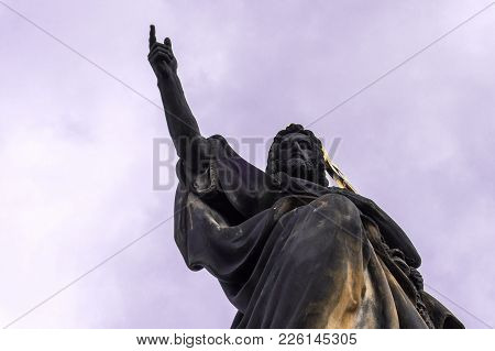 Statue Hands Indicates Free Space. Sculpture Of St. John The Baptist On The Charles Bridge In Prague