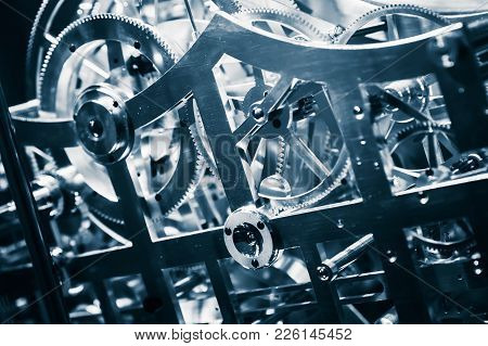 Clock Close-up Fragment With Shiny Gears