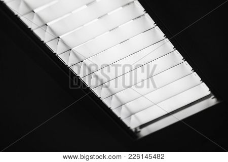 Built-in Office Ceiling Light With Fluorescent Tube Lamps, Close-up Photo