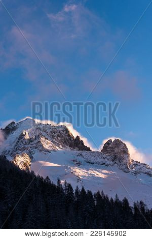 Storm Clouds Blowing Up Behind Alpine Peaks Aiguille Vert And Les Drus In The Afternoon Sun Against
