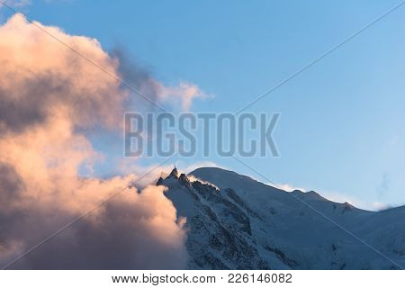 Horizon Of Mont Blanc And Aiguille Du Midi In Afternoon Sun With Storm Clouds Approaching Against A