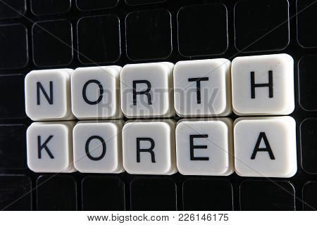 North Korea Text Word Title Caption Label Cover Backdrop Background. Alphabet Letter Toy Blocks On B