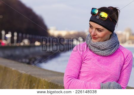 Woman Resting Relaxing After Doing Sports Outdoors. Fitness Girl Female Jogger Wearing Warm Sporty C