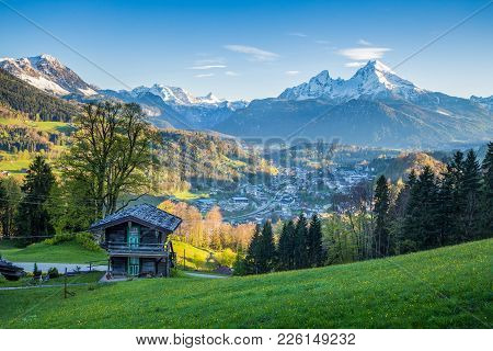 Beautiful View Of Idyllic Alpine Mountain Scenery With Traditional Mountain Cabin And Snowcapped Mou
