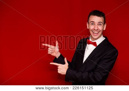 Young Stylish Man In Suit Pointing Finger And Looking In Camera. Photo For Business Projects, Produc