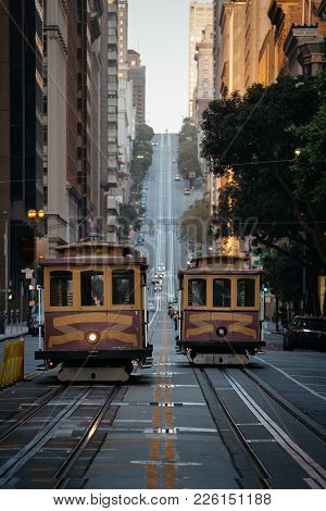 Classic View Of Historic Traditional Cable Cars Riding On Famous California Street In Morning Light