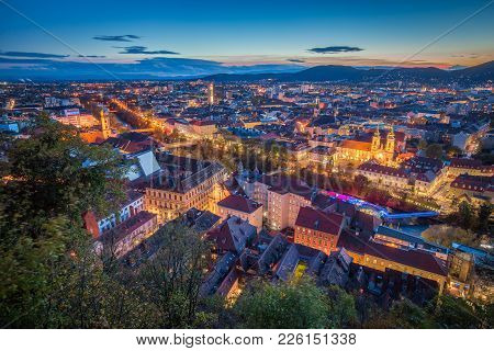 Panoramic Aerial View Of The Old Town Of Graz From Grazer Schlossberg (castle Hill) In Beautiful Eve