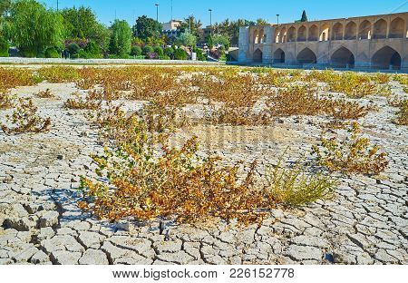 The Walk On Dried Up Bottom Of Zayandeh River Along The Historical Si-o-se-pol Bridge With Scenic Gr