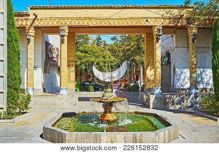 Isfahan, Iran - October 20,2017: The Beautiful Fountain With Sundial In Julfa Square Of Armenian Nei