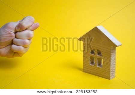 The Hand Shows A Gross Gesture Of The House, Property, Business. Hard Refusal, Disgust. A Rude Answe