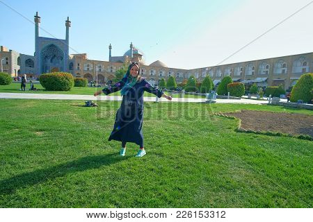 The Happy Smiling Female Is Spinning On The Lawn In Naqsh-e Jahan Square, Enjoying Vacation In Isfah