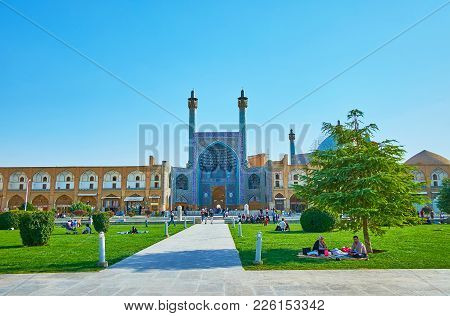 Family Rest In Naqsh-e Jahan Square, Isfahan, Iran