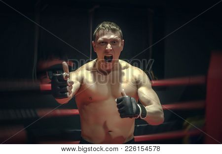 Angry And Aggressive Fighter Shows His Superiority In The Boxing Ring. Indisputable Champion Concept