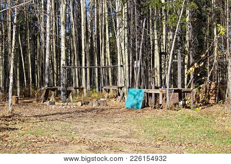 Tables And Poles Setup At A Popular Hunting Camp Spot.