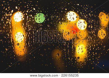 Rain Drops On Window. Peaceful Evening Or Night At Home When Raining Outside. Water Drops On Glass.