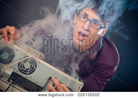 A Computer Nerd With Smoke Coming Out Of His Pc