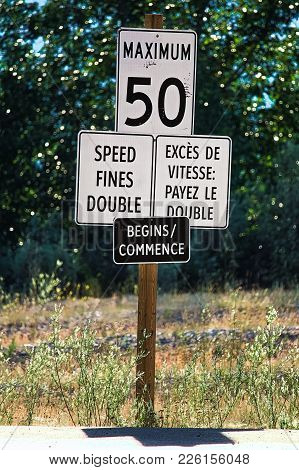 A Speed Fines Double Begins Sign Along A Highway.