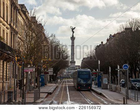 Bordeaux, France - December 27, 2017: Bordeaux Tram Stop On Line C (jardin Public) With The Monument