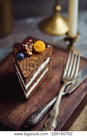 A Piece Of Chocolate Cake On Wooden Background. Happy Birthday Background