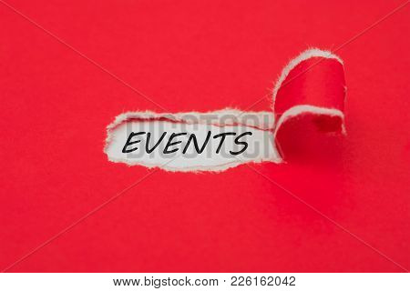 Torn Red Paper Revealing The Word Events. Upcoming Events Concept