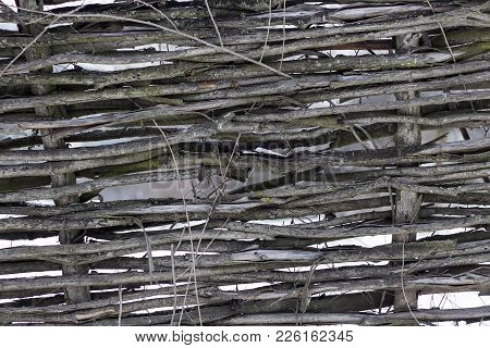 Close Up Of Traditional Russian Wattled Fence.