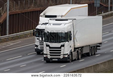 Two Lorries In Motion On The Motorway