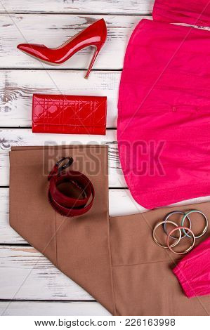 Set Of Feminine Outfit, Top View. Flat Lay Women Fashion Apparel And Accessories On Wooden Backgroun