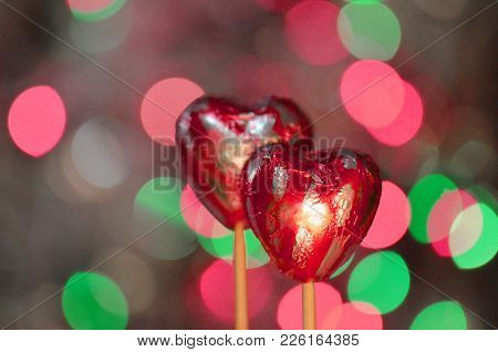 Heart Shape Chocolate Candies. Red Chocolate Hearts Candies