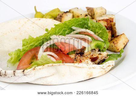 Chicken Pita Sandwich Plate Over White Background