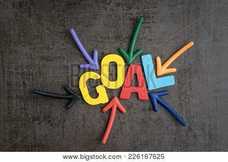 Business Success Target Or Goals Concept, Colorful Wooden Alphabets Goal At The Center With Pointing