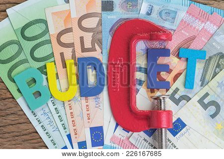 Europe Finance, Economic, Money Squeezing Idea, Colorful Alphabet Word Budget Using Red Clamp As G L