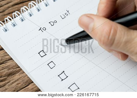 To Do Lists, Finish Work, Tasks Priority Concept, Closed Up Of Hand Holding Pen Writing List On Whit