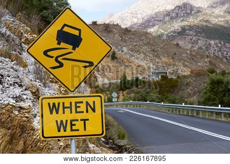 Slippery When Wet Signage On West Coast Of Tasmania, Australia