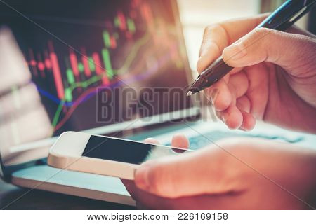 Businessman Writing The Trading Graph Of Stock Market